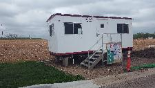 Vecino Construction Work Trailer moved to the Site